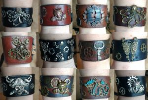 Handmade leather cuffs with metal designs