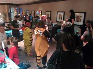 People in costumes standing in a room.